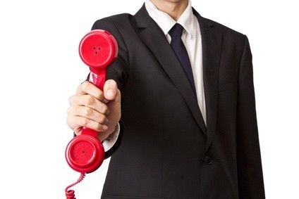 Holding Red Telephone