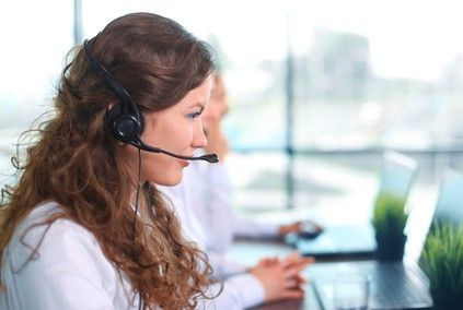 a woman cold calling another business